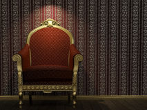 Golden and red armchair under spot light Stock Images