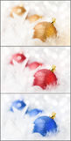 Golden, red and blue Christmas Baubles. In white feather Stock Images