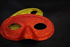 Golden and red carnival masks stock photography