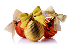 Golden and red Christmas balls with ribbon bows. Isolated on white background Royalty Free Stock Photos