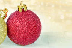 Golden and red Christmas baubles stock images