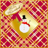 """Golden and red Christmas card decorated with a snow puppet and """"Merry Christmas"""" written in Spanish language. Golden and red Christmas card decorated Stock Image"""
