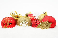 Golden,red christmas decoration on snow Stock Photography