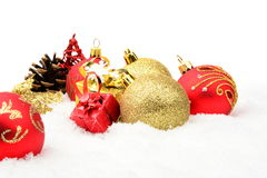 Golden,red christmas decoration on snow Royalty Free Stock Image