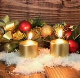 Christmas background Golden Candles on dark wooden board. Photo image royalty free stock image