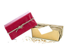 Golden and red christmas gift box. With blank card Royalty Free Stock Images