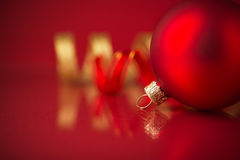 Golden and red christmas ornaments on red background. With copy space Stock Photos