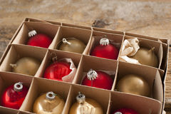Golden and red colored christmas ornaments Royalty Free Stock Image