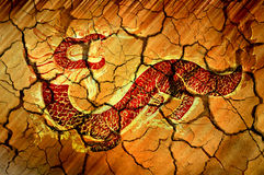 Golden Red Dradon on Cracked Bakcground Royalty Free Stock Photo