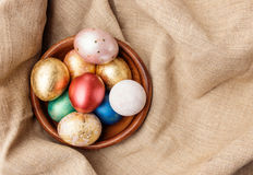 Golden and red Easter eggs Stock Photos