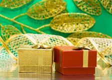 Golden and red gift boxes Royalty Free Stock Photos