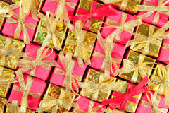 Golden and red gifts as background Stock Photos