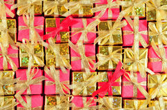 Golden and red gifts as background Stock Images