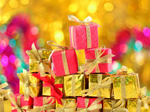 Golden and red gifts close-up Stock Images
