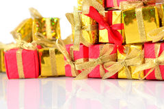 Golden and red gifts close-up Stock Photography