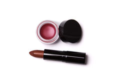 Golden red lipstick and lip gloss in jar Royalty Free Stock Image