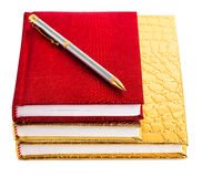 Golden and red notebooks Royalty Free Stock Photos