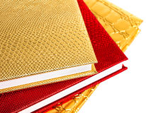 Golden and red notebooks Stock Photo
