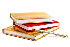 Golden and red notebooks Stock Photography