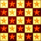 Golden and red stars over checked background Stock Photos