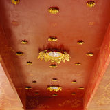 Golden on red thai, Buddha temple ceiling decoration Royalty Free Stock Photography