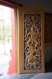 Golden and red Thai temple door sculpture Royalty Free Stock Photos