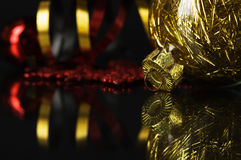 Golden and red xmas baubles Royalty Free Stock Images