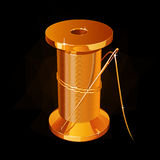 Golden reel of thread with a needle on a black background Royalty Free Stock Photos