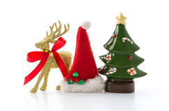Golden reindeer with christmas tree and hat Stock Images