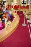 Golden reindeers near Christmas tree and sledge Stock Image