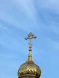 Golden religious sign on blue sky, clouds Royalty Free Stock Photos