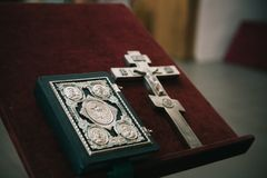 Golden religious utensils - Bible, cross, prayer book, missal. Details in the Orthodox Christian Church. Russia. Royalty Free Stock Photography