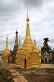Golden renovated temple ruins in Inthein, Myanmar Royalty Free Stock Photos
