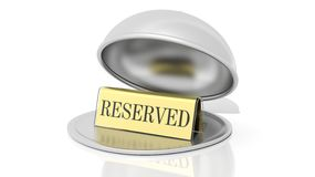 Golden reservation sign inside open serving dome dish Stock Photography