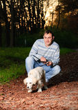 Golden retriever and man in park Royalty Free Stock Photography