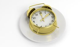 Golden retro alarm clock on a plate Stock Image