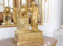 Golden retro baroque clock. Royalty Free Stock Photos