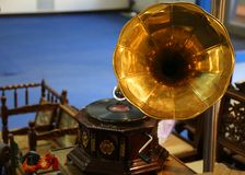 Golden retro gramophone. Among other vintage art objects stock photos
