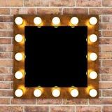Golden retro makeup mirror on brick wall Royalty Free Stock Photo