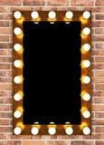 Golden retro makeup mirror on brick wall Stock Photography