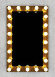Golden retro makeup mirror on concrete wall Royalty Free Stock Images
