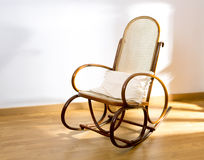 Golden retro rocker wooden swing chair Stock Photos