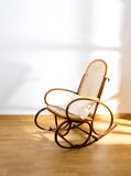 Golden retro rocker wooden swing chair Stock Images