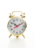 Golden retro style alarm clock Royalty Free Stock Image