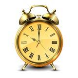 Golden retro style alarm clock. Stock Image