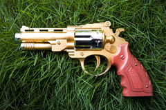 Golden revolver Royalty Free Stock Images