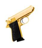 Golden revolver gun Royalty Free Stock Images