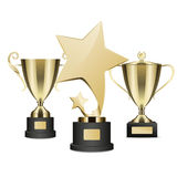 Golden Rewards Collection of Three on Stands. Royalty Free Stock Images