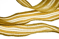 Golden ribbon. Golden curly riibon isolated on white Stock Photography
