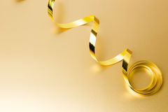 Golden ribbon Stock Images